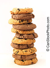 Stack of several chocolate and hazelnut cookies with chocolate chips and cranberries