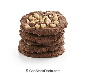stack of homemade chocolate cookies with hazelnuts isolated on white background