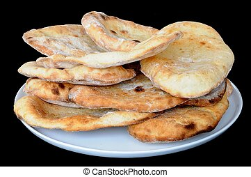 Stack of Indian Naan bread. - Freshly cooked coriander and...