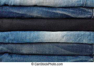 Stack of jeans background
