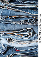 stack of jeans on white background