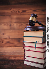 stack of law books with judge's gavel on top