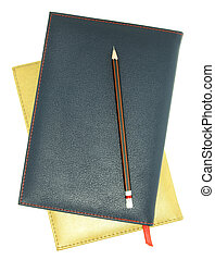 stack of leather notebook and pencil isolated on white with clipping path