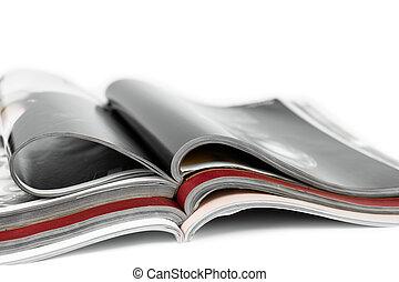 Stack of magazines on isolated white