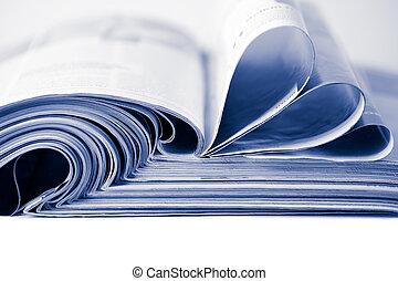 stack of magazines toned blue isolated