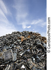 Metal Garbage - Stack of Metal Garbage in front of blue sky