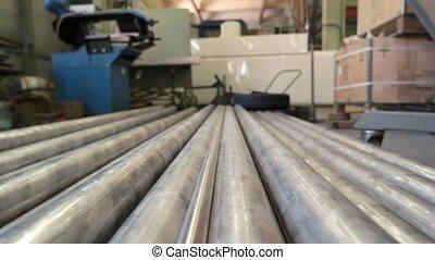 Stack of metallic pipes indoor. Long pieces of metal.