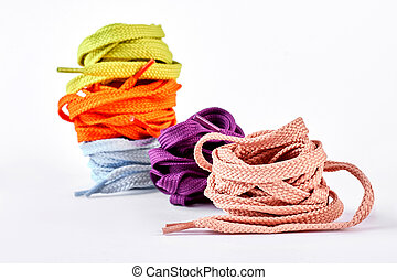 Stack of multicolored shoe laces. Decoration from...