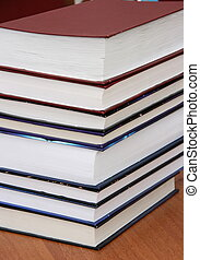 Stack of new books with hard cover spine