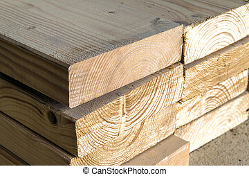 Stack Of New Wooden Studs At The Lumber Yard. Wood Timber Construction  Material. Shallow