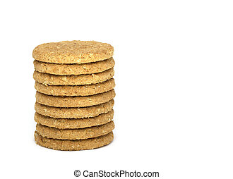 Stack of nine oaty biscuits isolated on white