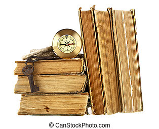 Stack of old books, compass, old keys and rope on a white background