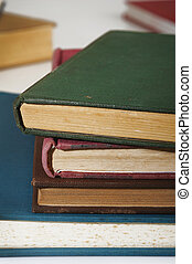 Stack of old books on white