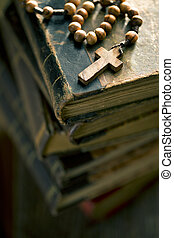 old books with rosary beads