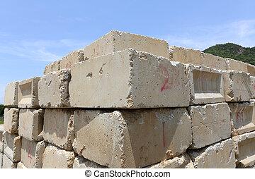 concrete blocks - Stack of old concrete blocks against a...