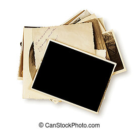 Stack of old photographs isolated on white background