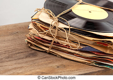 Stack of old vinyl records tied with rope