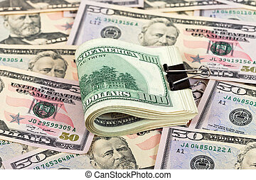 Stack of one hundred dollar bills row on money background