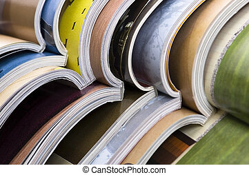 Stack of open magazines