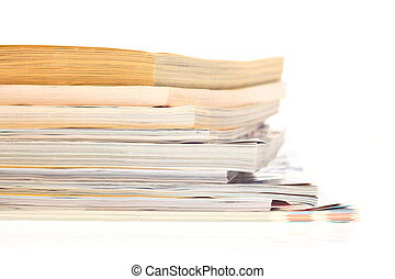 stack of opened magazines
