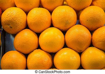 Stack of Oranges at Market
