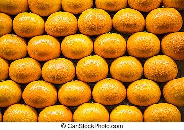 Stack of Oranges in Market