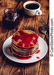 Stack of pancakes with berry fruit marmalade