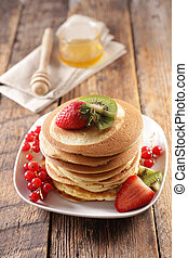 stack of pancakes with berry fruit