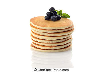 stack of pancakes with blueberries on white
