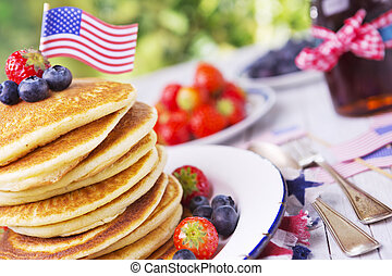 Stack of pancakes with fresh fruit