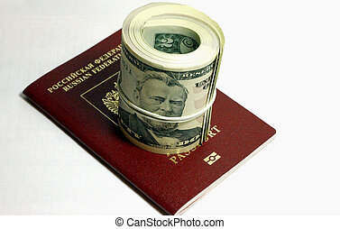 Stack of paper usa dollars and red passport under