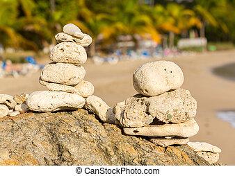 Stack of pebbles by ocean seaside
