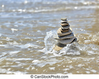 stack of pebbles in the sea