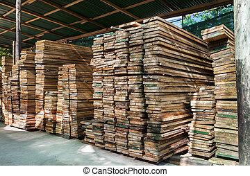 stack of pile wood bar in lumber yard factory use for construction wood industry