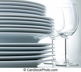 stack of plates and glasses