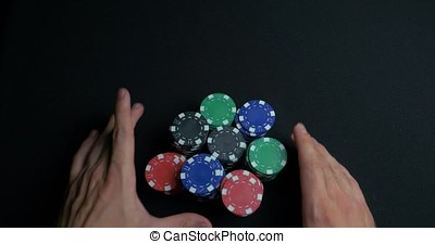 Stack of poker chips and two hands on table. Closeup of...
