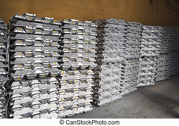 Stack of raw aluminum ingots in aluminium factory