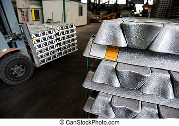 Stack of raw aluminum ingots in aluminum profiles factory,...