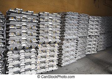 Stack of raw aluminum ingots in aluminium factory