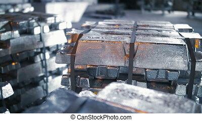 Stack of Raw Aluminum Ingots - Metal Ingots in Warehouses....