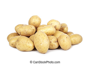 Stack of raw potatoes - Stack of raw and fresh potatoes on ...