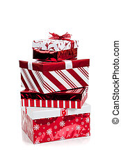 A stack of red and white wrapped Christmas presents on a white background
