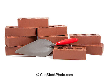 Stack of red bricks on white - A stack of red bricks on a...