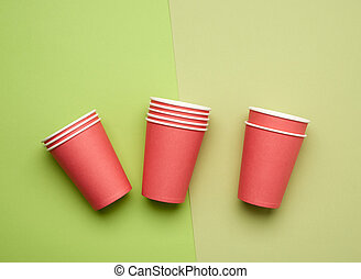 stack of red paper disposable cups on a blue background, flat lay, concept eco-friendly