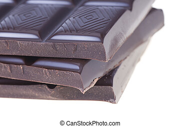 Stack of rich dark chocolate on a white background