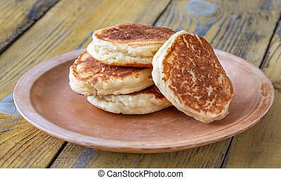 Stack of ricotta pancakes on the plate