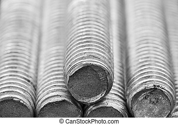 Stack of round steel bar - iron metal rail lines materia.