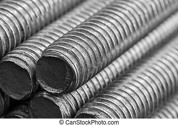 Stack of round steel bar - iron metal rail lines material .