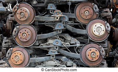 stack of rusted metallic car parts in garage