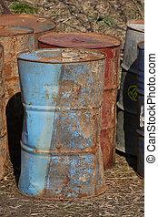 Stack of industrial rusting barrels